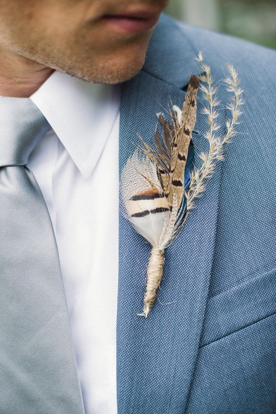a feather and dried herb wedding boutonniere is a fun and boho touch to rock