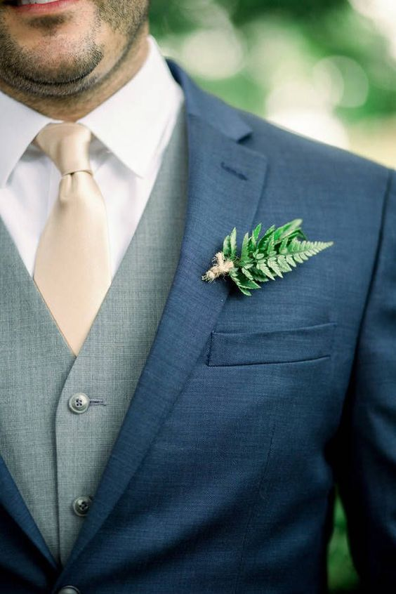 a fern and yarn wedding boutonniere is a fresh and lively wedding accessory
