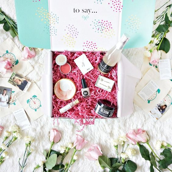 a glam box with champagne, lip gloss, lipsticks, a soap and some other cute stuff to look wow