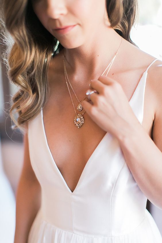 a gorgeous crystal drop layered necklace will fit a plunging neckline wedding dress