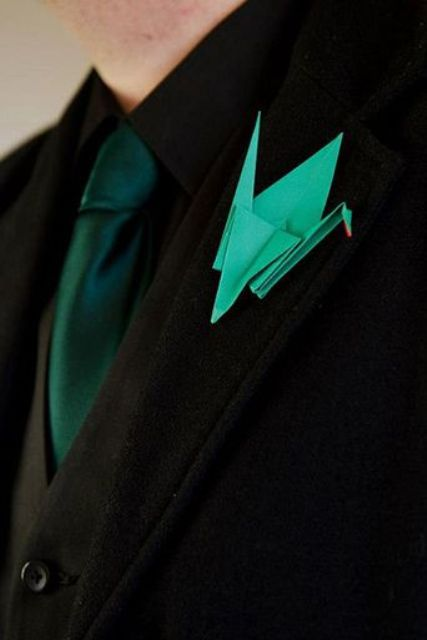 a green origami boutonniere will accent a groom's look and will bring happiness as this crane is its symbol