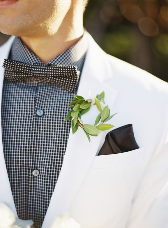 a greenery wreath will refresh any groom's look and make it ultimately chic and bold