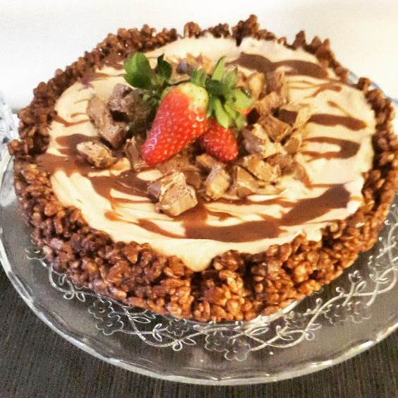 a krispie rice wedding cake with a caraml top, chocolate and strawberries to make it really delicious