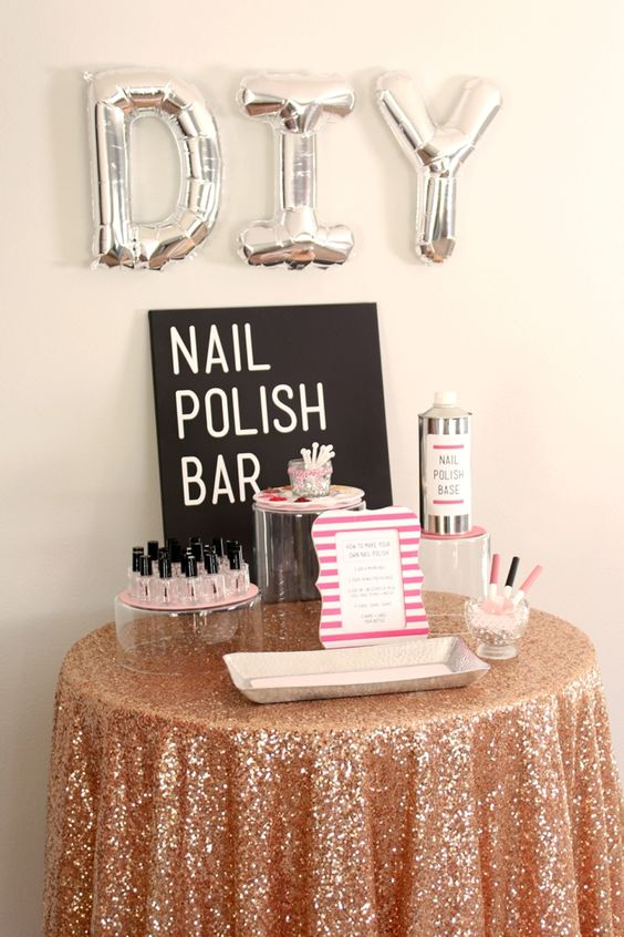a nail polish bar with balloon letters, a sign, lots of nail polishes and all the necessary stuff