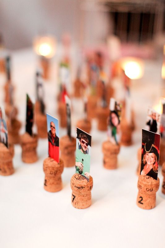 a nice idea to display your escort cards   print out photos and place them on wine corks