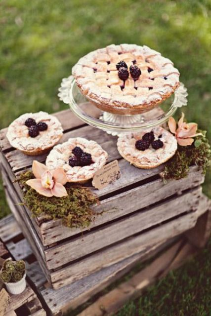 a rustic wedding pie bar with moss, blooms and some delicious pies is all you need for a small wedding