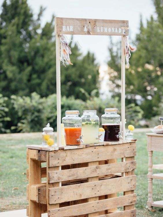 a rustic wooden pallet wedding drink bar is veyr easy to build and looks simple and cute, you may also paint or stain the bar
