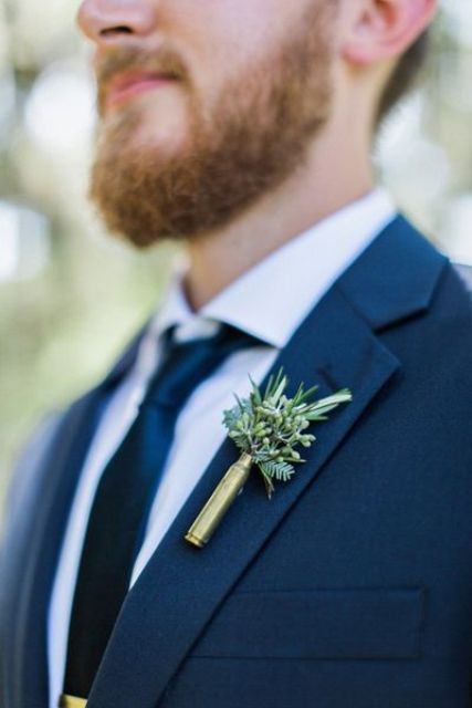 a shotgun and greenery boutonniere is a unique and creative accent to try