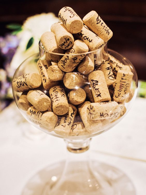a simple and fun wedding guest book of a glass jar and wine corks is a perfect fit for a vineyard wedding