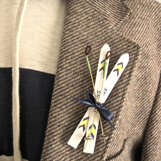 a ski boutonniere is a fun and quirky accessory for a ski-loving wedding and groom