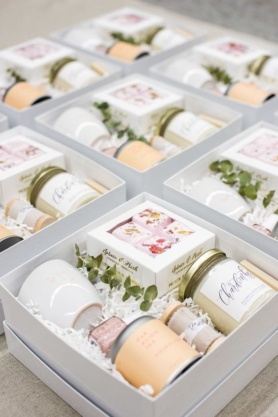a spa bridal shower gift box with candles, floral soaps, a mug, nail polish and some other cool stuff