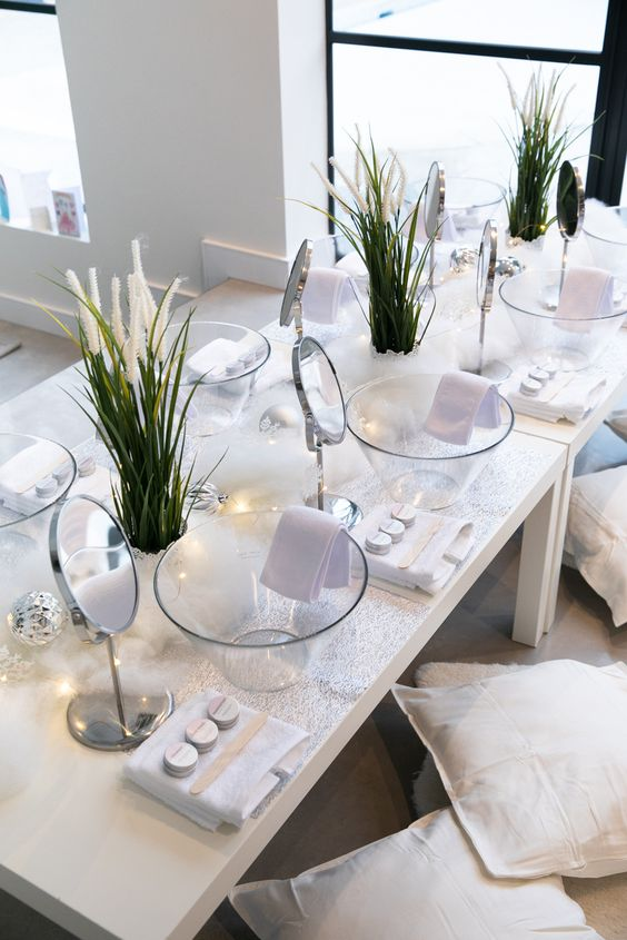 a spa bridal shower setting with mirrors, glass bowls, lights and various kinds of masks and treatments to try