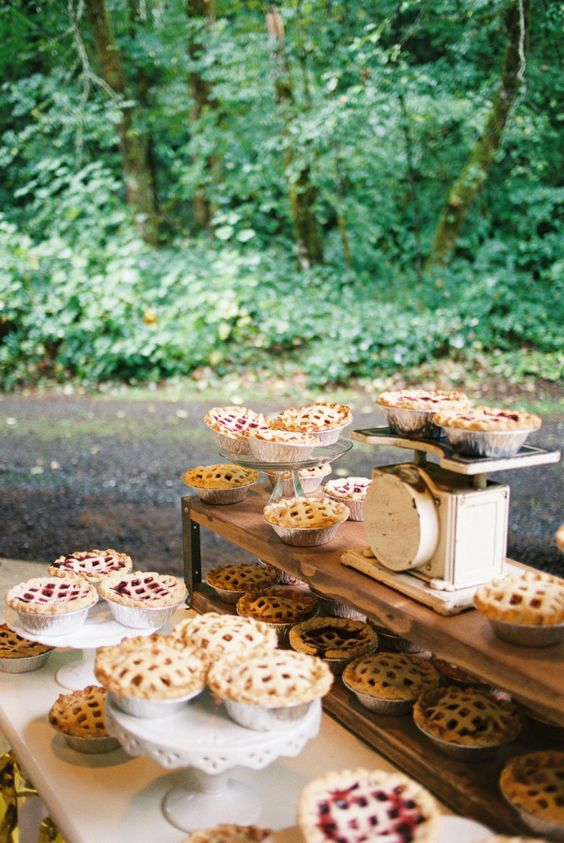 a vintage pie bar with a wooden shelf, vintage scales and cute stands with lots of delicious mini pies is cool