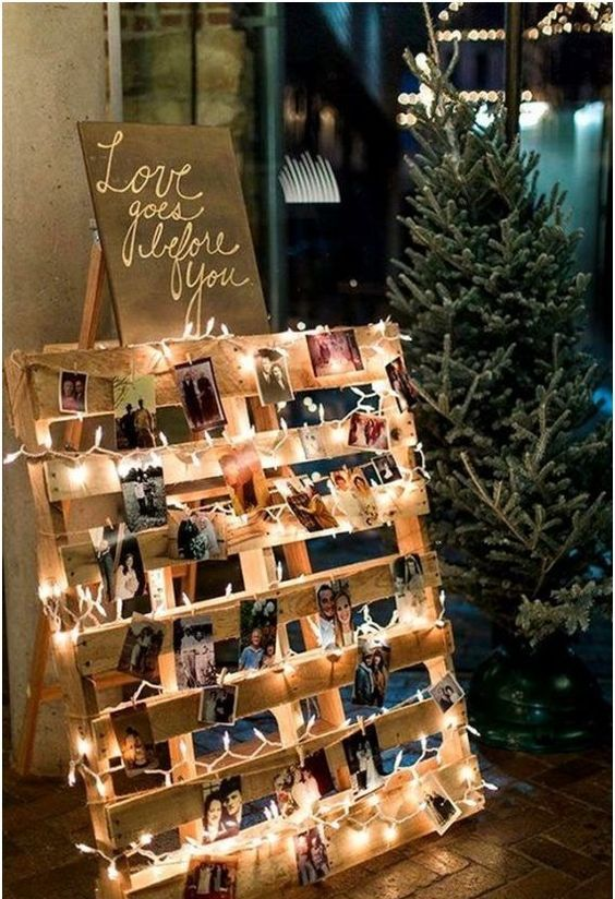 a wedding sign with lights and family photos is a cozy and homey wedding decoration for every wedding