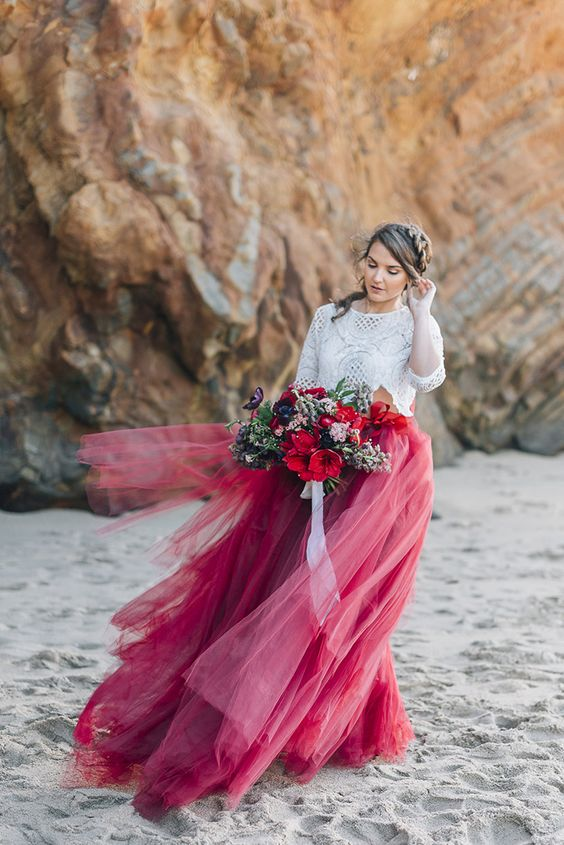 a white lace crop top with long sleeves, a bright burgundy and red tulle maxi skirt for a boho bridal look
