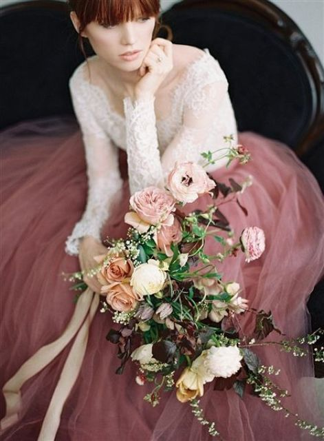a white lace top and a dusty pink tulle maxi skirt for a bold and chic bridal look