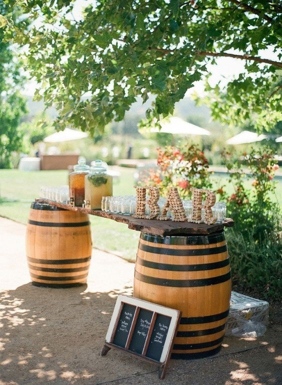 a wine cork letter sign is a cool idea to mark a bar or a station instead of a usual wedding sign