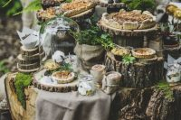 a woodland wedding pie bar with lots of tree stumps and wood slices, moss, greenery and succulents is amazing for a woodland wedding