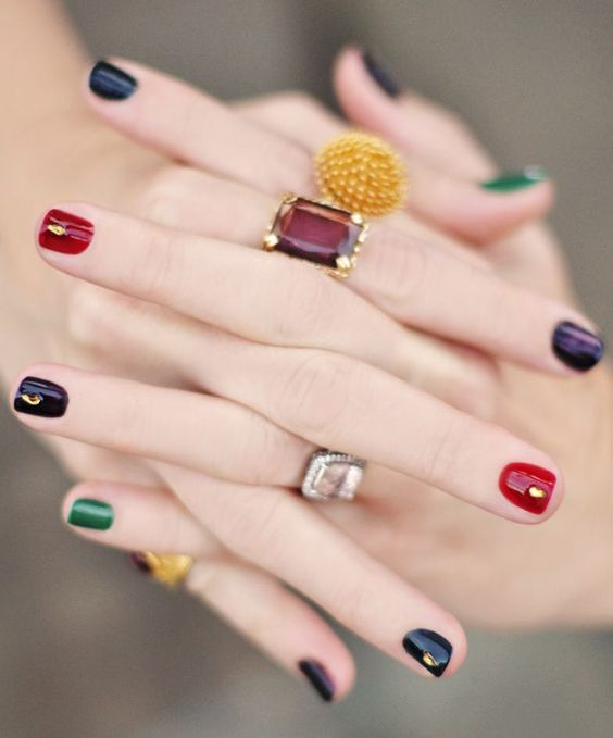 all-different jewel-toned nails with gold studs are super fun, bright and refined and will bring much color to your look