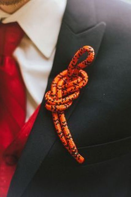 an orange rope wedding boutonniere is a lovely and bold piece to rock, with a nice knot