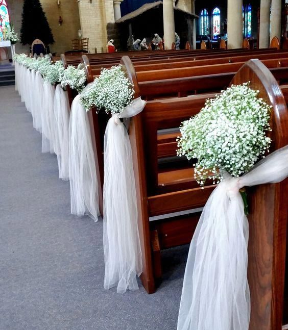 baby's breath and white tulle wedding aisle decorations for an elegant and rustic feel