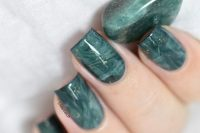 beautiful malachite-inspired nails with marbleizing touches and glitter look fantastic and very edgy