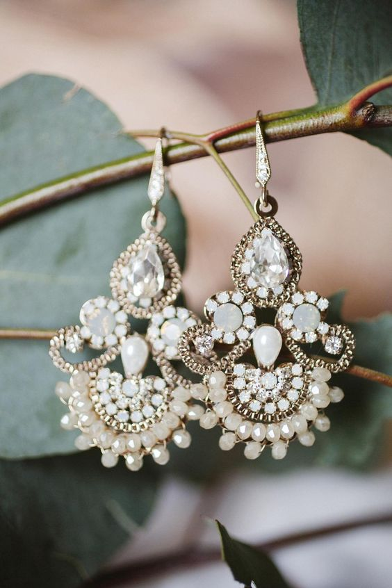 beautiful statement earrings for the bride to wear on the wedding day - make sure they match her outfit