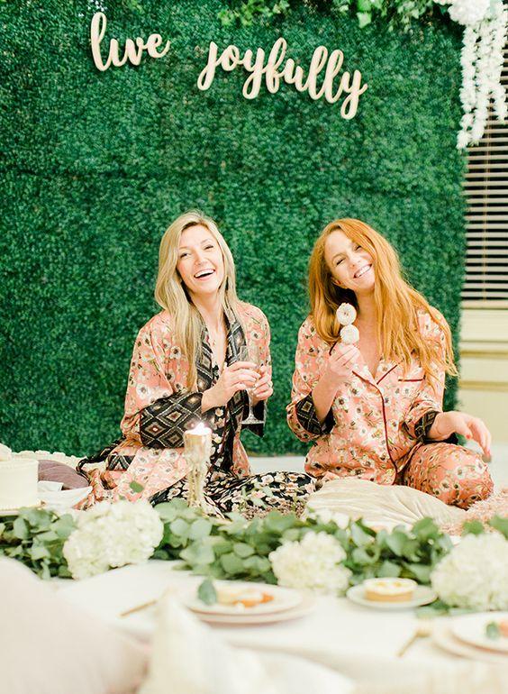 bridesmaids wearing matching pink floral pajamas at the spa bridal shower