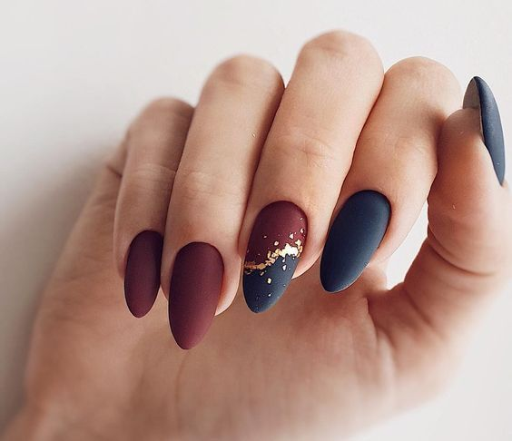catchy matte nails - black and burgundy ones, with an accent nail with gold leaf look very bold and unusual
