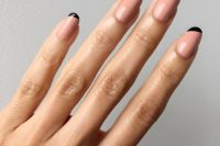 color block nude and black nails are a fresh take on classic French manicure and it looks bold