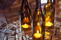 cozy wedding decor with wine corks, wine bottles with candles is very easy and budget-friendly