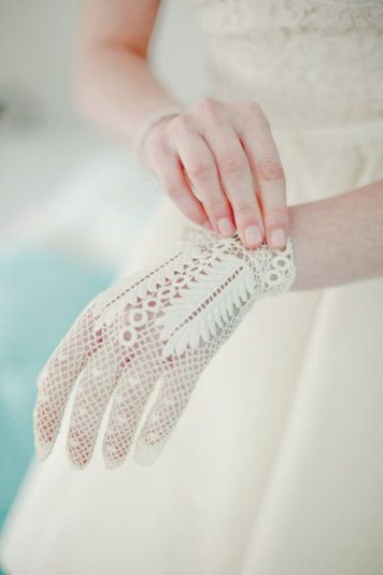 elegant white crocheted gloves with lovely patterns are ethereal and very chic for a vintage-loving bride
