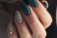 glossy hunter green, grey and silver glitter nails and an accent nail with heavy embellishments for the bride