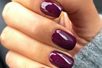 glossy purple nails are a perfect modern manicure for a fall bride that will bring a jewel tone to the outfit