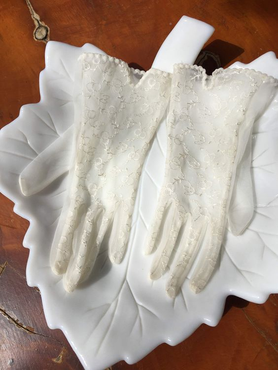 ivory and gold lace gloves with an elegant ribbon edge are chic accessories for a vintage bride