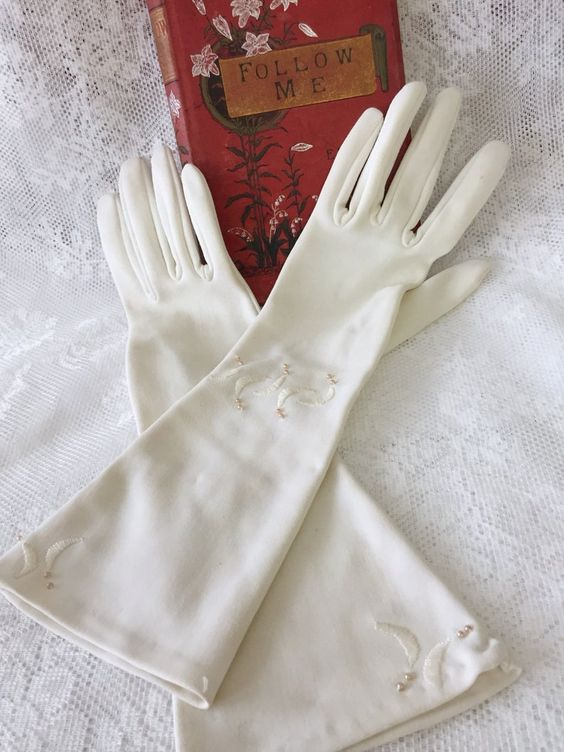 long vintage cream crescent embroidered gloves with pearls and beads look very elegant