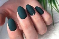 matte black nails with an accent nail with shiny dots are bold and chic and will match many bridal looks