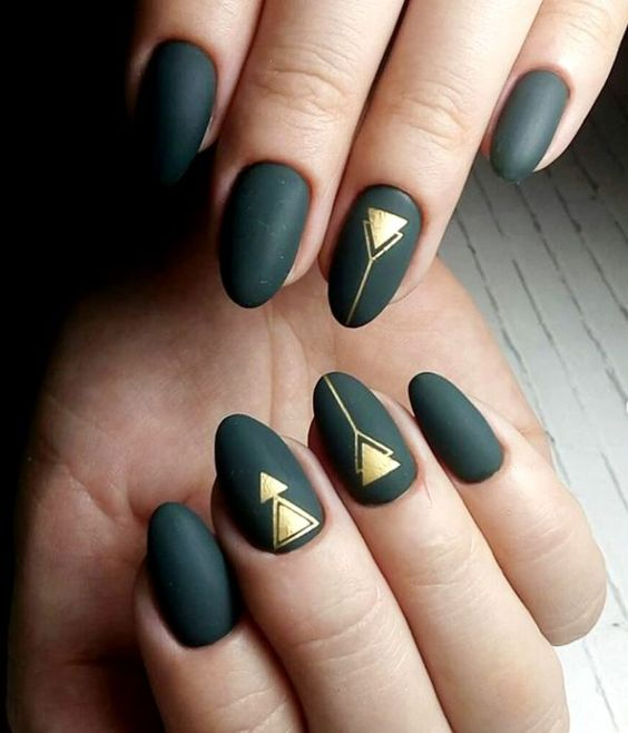 matte black nails with gold geometric detailing are nice for a fall art deco bride