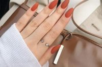 matte rust-colored nails are a timeless fall idea to rock and they will bring a fall shade to your outfit