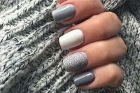 mismatching grey, graphite grey, white and silver glitter nails will look neutral enough yet scream fall