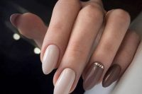 nude, mauve and brown nails and an accent nail with rhinstones look very chic and very beautiful for a fall bride