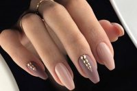 nude, mauve and purple glossy and matte nails with gold embellishments look very refined and very chic