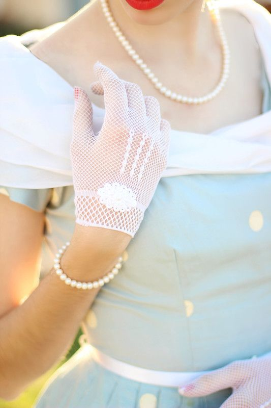 vintage white crochet gloves with patterns and an oval scallope edge applique are romantic