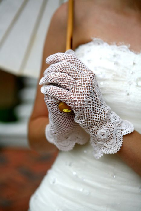 white crochet floves with a scallop edge and crocheted flowers look chic and very elegant