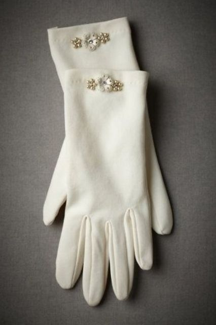 white gloves with pearl embellishments and flowers look girlish and very elegant