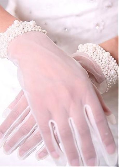 white mesh gloves with refined and wide pearl and bead wrists look very glam and elegant