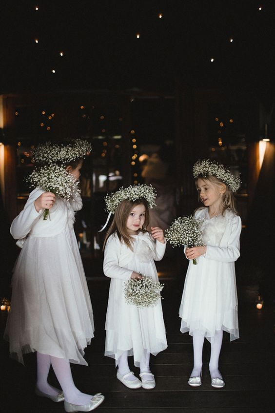 white midi dresses with layered skirts, white tights, white silky flats and baby's breath crowns