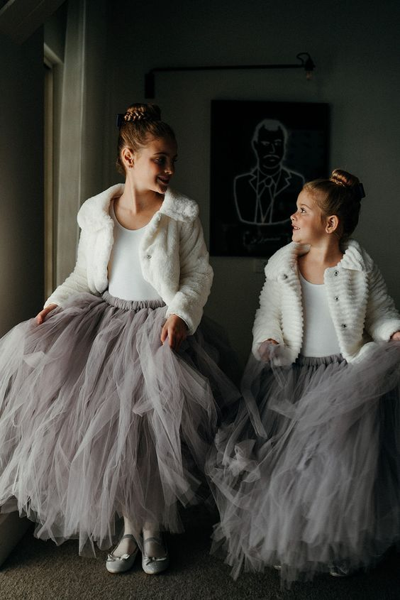 white tops, grey tutu maxi skirts, neutral flats and faux fur coats plus top knots for chic and refined looks