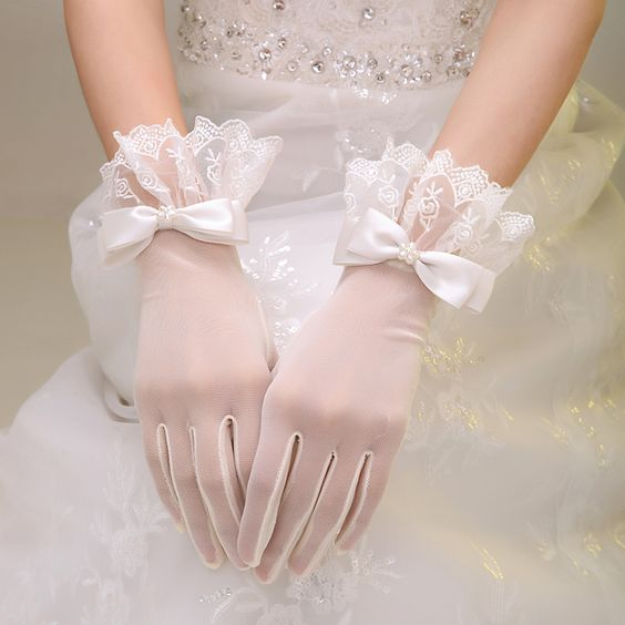 white tulle gloves with delicate lace edges and silk bows with pearls for a romantic and chic look