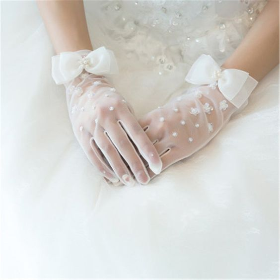 white tulle gloves with embellishments, floral appliques and large bows accented with pearls